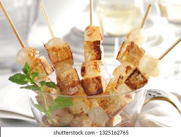 Vegan food. Grilled veggie tofu skewers with onions.