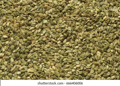 Vegan food. Raw pumpkin seeds for roasting closeup