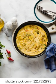 vegan frittata without eggs in a pan on the table. healthy italian appetizer for the whole family or party