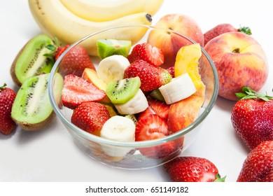 Vegan fruit salad with strawberries, kiwi and banana