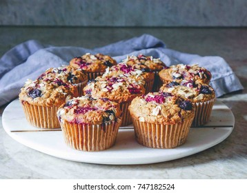 Vegan Gluten-free Oatmeal Banana Muffins with Mixed Berries. Healthy Dessert, Pastry. Selective Focus, toning.