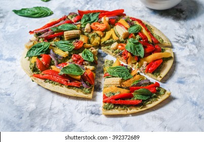 Vegan, Gluten-free Pizza with Basil, Kale Pesto and Vegetables, Chickpea Crust/ Selective Focus, Toning