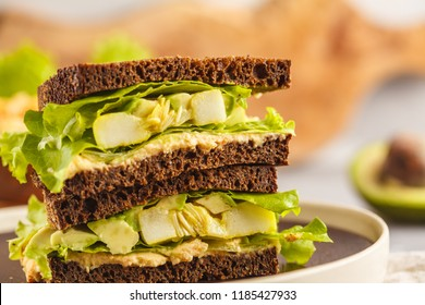 Vegan green sandwich with hummus, baked vegetables and avocado. Clen eting concept.