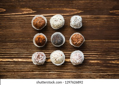 the vegan of handmade candy on a wooden background. Fitness sweets. candies without sugar.