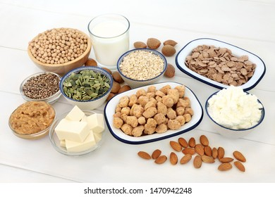 Vegan health food selection, with bean curd, legumes, nuts, seeds, cereals, sos mix, almond milk and yogurt. Super foods high in protein, antioxidants, vitamins and dietary fibre.