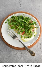 Vegan healthy salad made microgreen sprouts peas, quinoa, radish, mint and yogurt