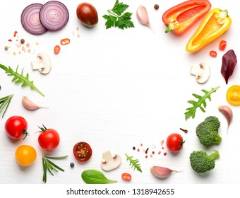 Vegan ingredients for homemade pizza on white wooden background. Copyspace. Top view .