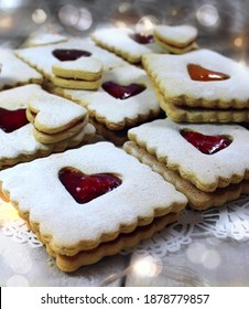 Vegan Linzer Cookies with heart shapes and Christmas lights.