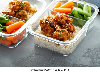 Vegan meal prep with bbq cauliflower with rice, carrots and sugar peas