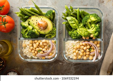 Vegan meal prep containers with cooked rice, chickpeas and vegetables