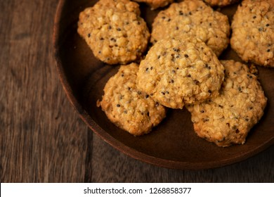 Vegan oatmeal chiaseeds cookies on plate with natural light.