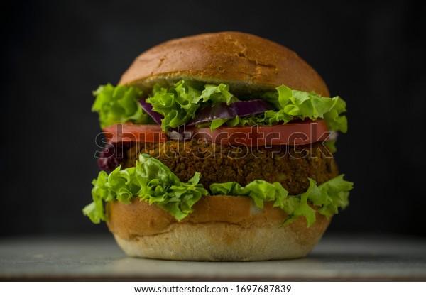 Vegan organic burger with vegetables