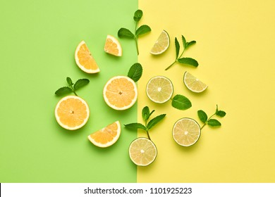 Vegan Organic Food Concept. Orange Citrus Lemon Fresh Fruit with Mint leaves. Creative Layout. Flat lay. Trendy Summer fashion Style. Minimal Design Art. Bright Color.