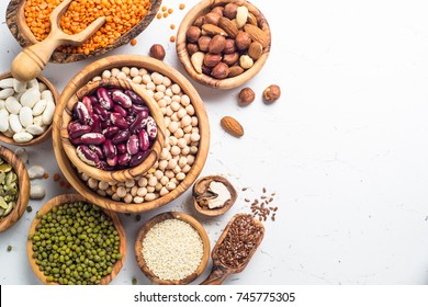 Vegan protein source. Legumes - lentils, chickpeas, beans, green mung bean. seeds and nuts on white background. Top view copy space.