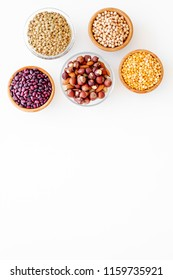 Vegan protein source. Legumes and nuts on white background top view copy space