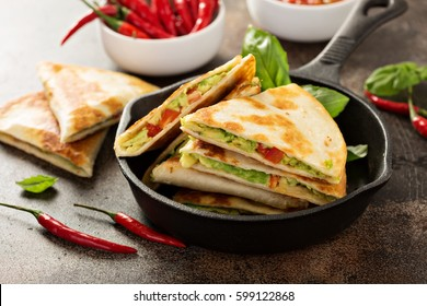 Vegan quesadillas with avocado and red pepper served with tomato salsa