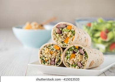 Vegan quinoa wraps with chickpea, kidney beans and pumpkin