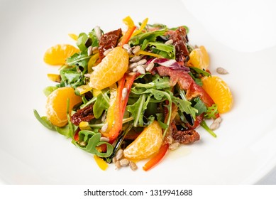 vegan salad with arugula and mandarines