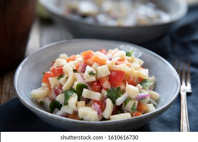 Vegan salad with hearts of palm, red onion, pepper, cilantro and lime dressing.