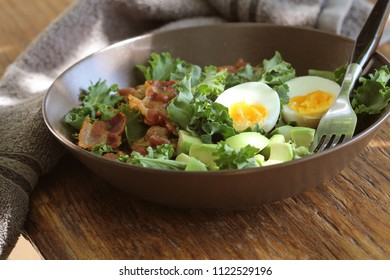 Vegan salad with kale,avocado, crispy bacon, egg and Vinaigrette dressing