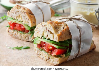 Vegan sandwich with avocado and tomatoes