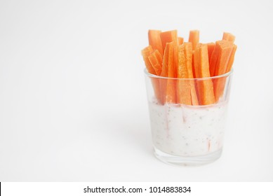 Vegan Snack Carrot Batons in a Glass Cup Served as Crudites Isolated a Healthy Appetizer to a Meal