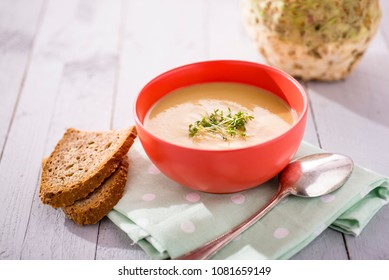 vegan soup in a red bowl