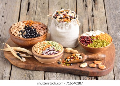 Vegan sources of protein. Lentils, chickpea, legumes on wooden background. Selective focus.