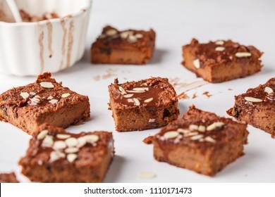 Vegan sweet potato brownie on white table. Healthy vegan food concept.