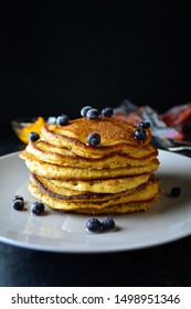Vegan Sweet Potato Pancakes with Blueberries and Maple Syrup