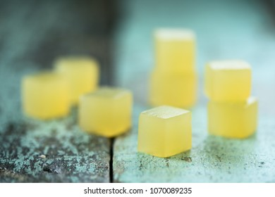 Vegan sweets. Homemade agar jelly cubes on shabby rustic background