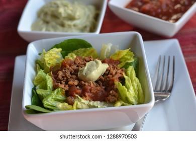 Vegan Taco Salad made with walnut, avocado, salsa, lettuce and spinach