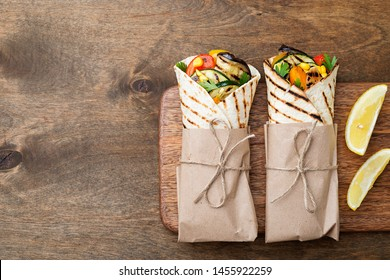 Vegan tortilla wrap, roll with grilled vegetables.