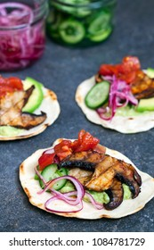 Vegan tortillas with mushrooms, avocado, pickled onions and cucumber