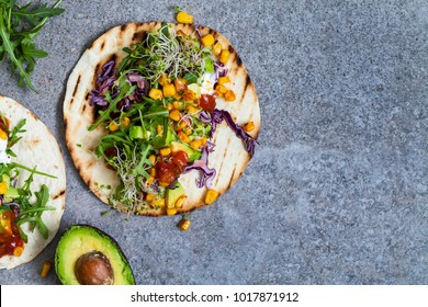Vegan tortillas with sweetcorn, avocado, red cabbage and broccoli sprouts