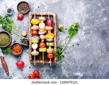 Vegan vegetable skewers on a cutting board.Vegetables for grilling