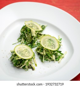 Vegan and vegetarian cuisine. Cucumber salad on white plate. Food concept. Square format or 1x1 for posting on social media.