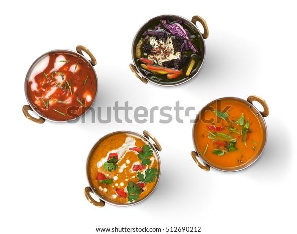 ベガン料理、ベジタリアン料理、辛い辛さとクリーミーなインドのスープ、サラッド、銅鉢。白い背景に伝統的なインド料理の品揃え。健康な東洋の地元の食べ物