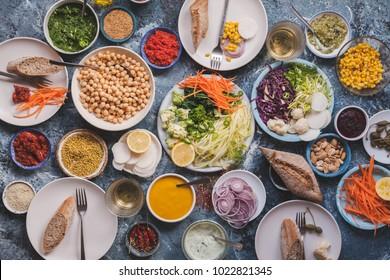 Vegan veggies meals on dinning table flat lay detox dieting food concept