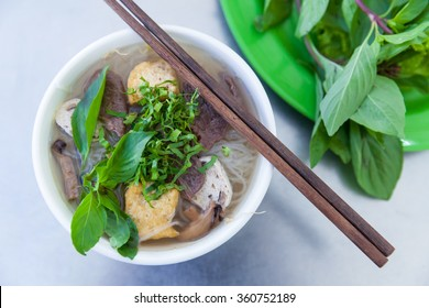 Vegan version of Pho famous vietnamse noodle soup, served with fresh herbs at the buddhist eatery, Nha Trang, Vietnam.