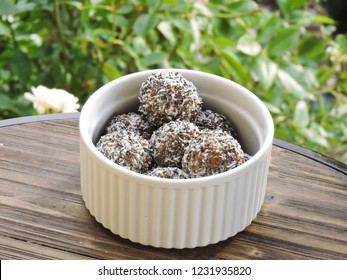 Vegan/Plant based chocolate and coconut bliss balls photographed outdoors