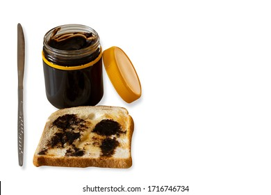 Vegemite on toasted placing with knife healthy breakfast with isolated dropped shadow white background