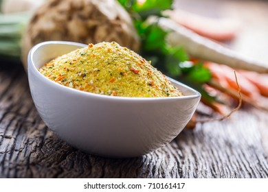 Vegeta seasoning spices condiment with dehydrated carrot parsley celery parsnips and salt with or without glutamate.