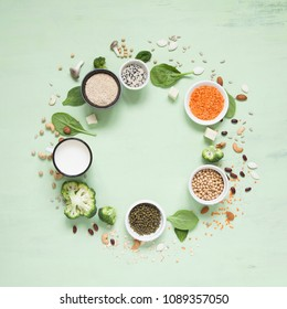 Vegetable albumen sources. Plant protein (beans, nuts, vegetables, mushrooms, seeds) forming a circle. Vegan and vegetarian food concept. Flat lay.