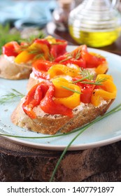 Vegetable appetizer. Slice of bread, cream cheese and multi-colored grilled bell pepper with olive oil. Rustic style
