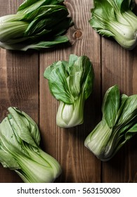 Vegetable assortment, fresh green Chinese cabbage, bok choy, pok choi or pak choi on old wooden old background