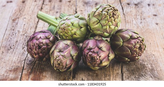Vegetable background with fresh artichokes