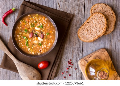 Vegetable bean soup in a bowl on rustic background