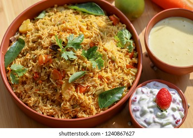 Vegetable Biryani a flavorful Indian rice dish with peas, carrots and potatoes with spicy spices.