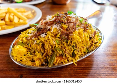 Vegetable Biryani. Vegetarian fried rice with basmati rice and fresh vegetables. South Indian turmeric rice garnished with nuts curry leaves. Keema / Hyderabadi Kheema Biryani